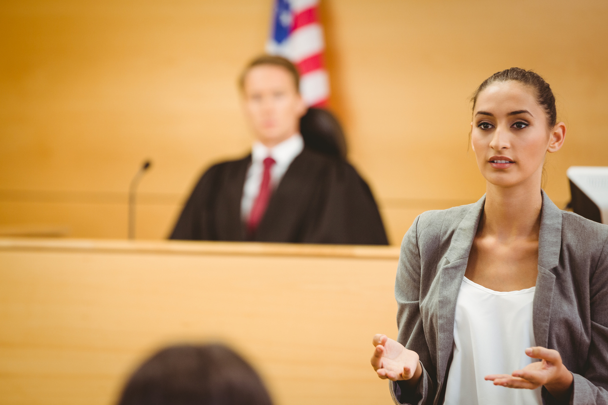 Female lawyer addressing jury in courtroom